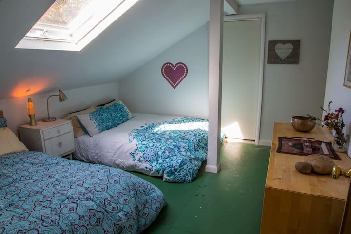 The Sky Room - 2 queens plus 4 twins - upstairs off yoga room - note more beds thru door.