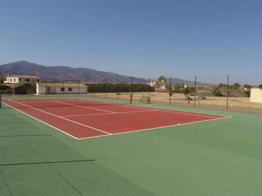 Private all weather tennis court showing mountain views in background