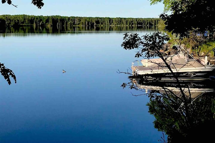 Walk down to the lake/Winnipeg river and this is your view (our dock) and your launch point if canoeing or kayaking.