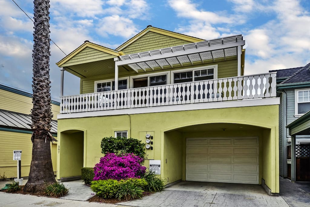 Front of duplex with private parking garage
