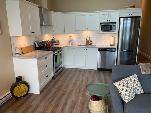 The unit offers a full kitchen including dishwasher and gas range to cook.
