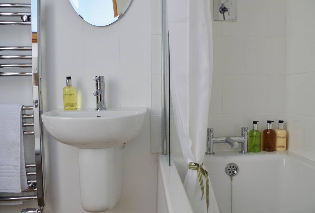 Modern ensuite bath-rooms with bath and shower.