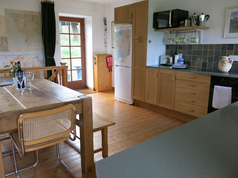 Open plan living area. Large table, back door to garden