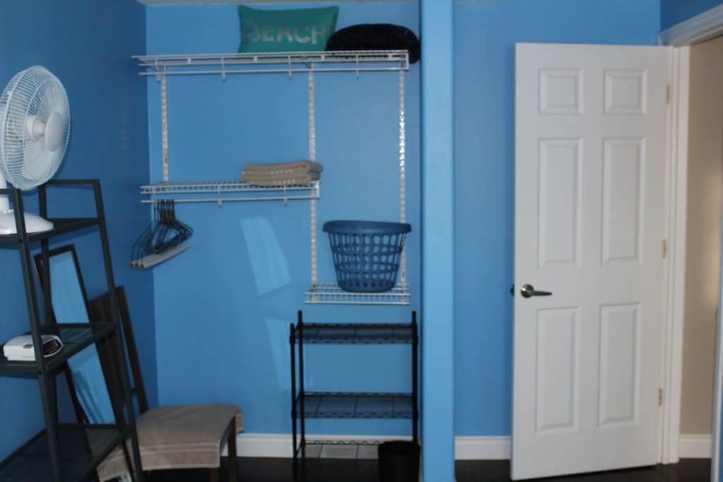 Open concept closet and storage space.