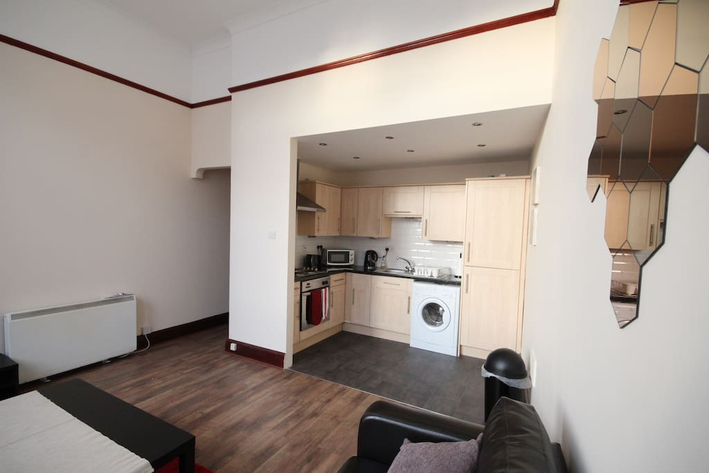 Open plan kitchen with all necessary appliances.