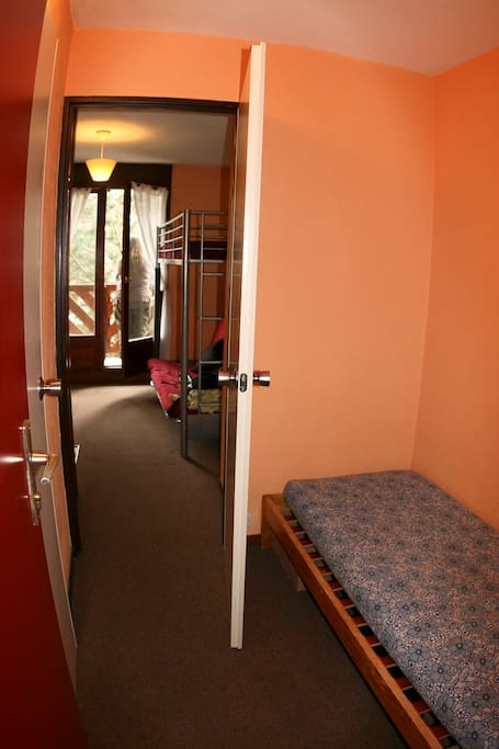 Hallway and single bed.