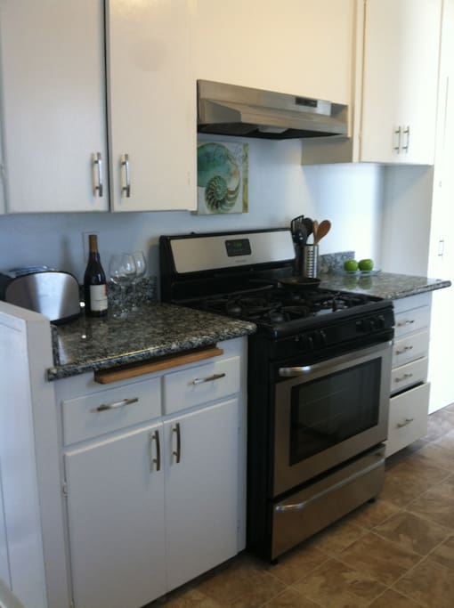 New stainless steel appliances and granite counter tops.