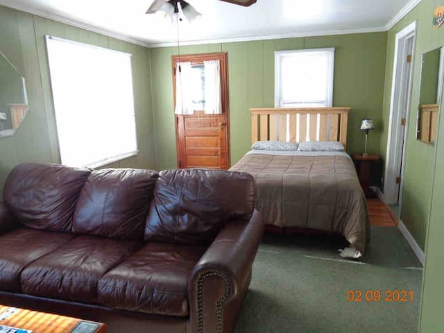 Second bedroom with double bed has it's own sitting area with a tv and sofa.
