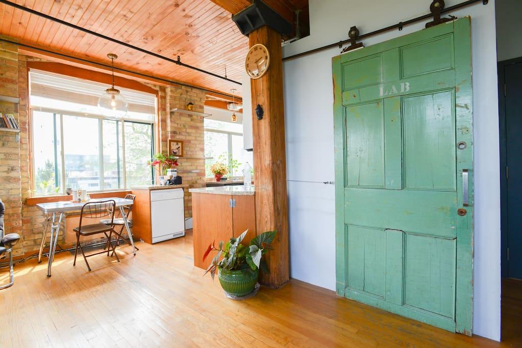 Barn door to bathroom - dining table