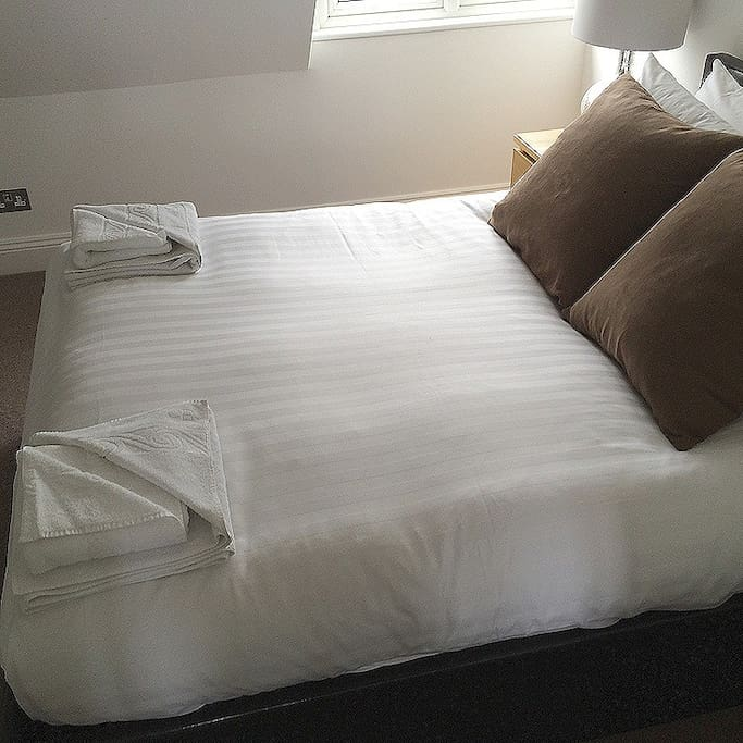 Queen Sized Bed, Feather Duvet with Fresh Towels