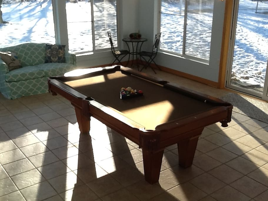 Four season sunroom with pool table and radio great place to hang out, enjoy breakfast in here, sit and watch the wildlife or deers, turkeys and many more
