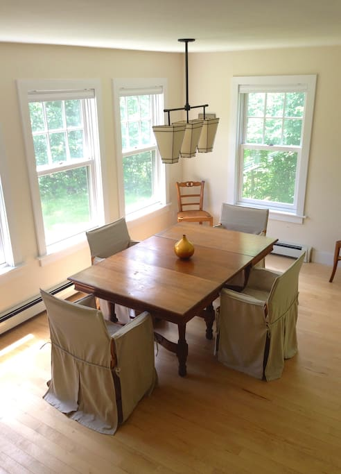 Oak farm table in the dining room expands to seat 6+