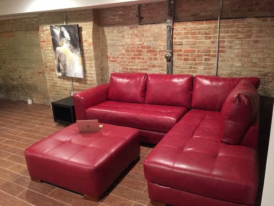 Beautiful exposed brick living room in charming apartment