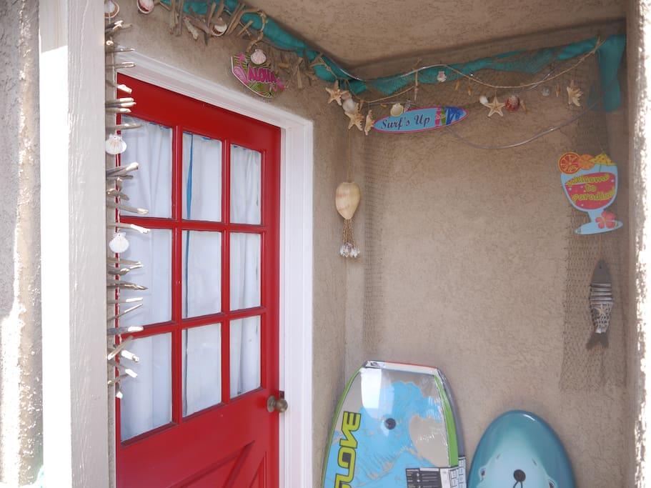 Entrance to your bungalow with boogie boards waiting for you.