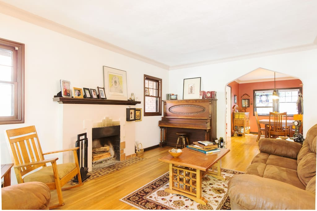 Comfy living room with a 111 year old upright grand piano.   Anybody play?