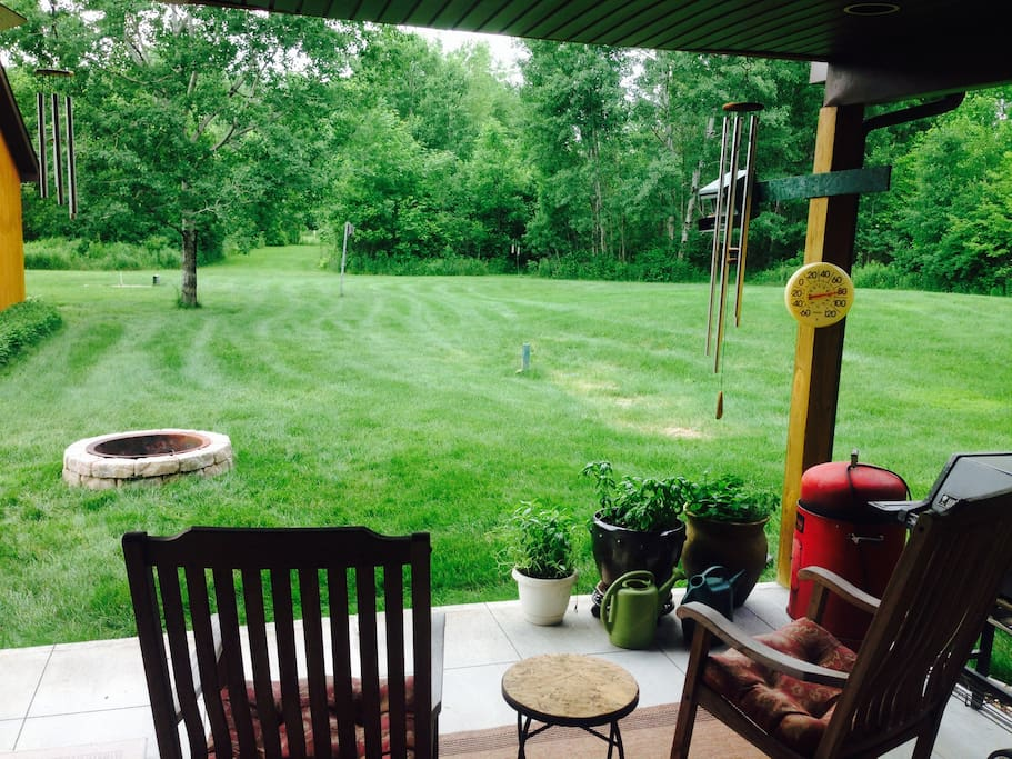 Patio/backyard and fire pit.  2 gas grills!  Horseshoe pits, large lawn, trails.