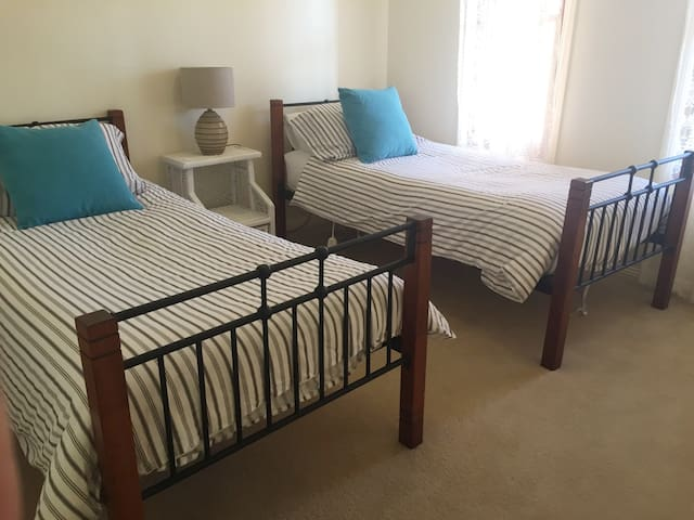 Two single beds large built in Robe.
