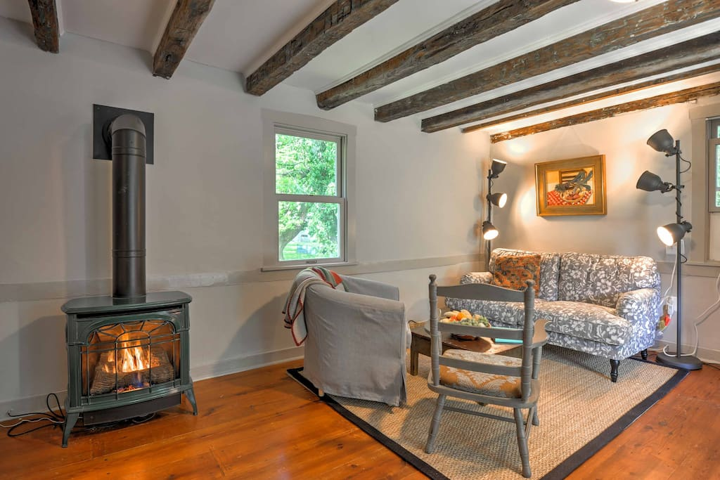Cozy up in this quaint living room by the gas-heating stove.