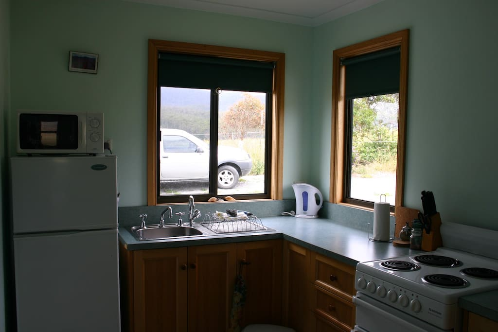 Full kitchen with microwave, fridge freezer and oven.