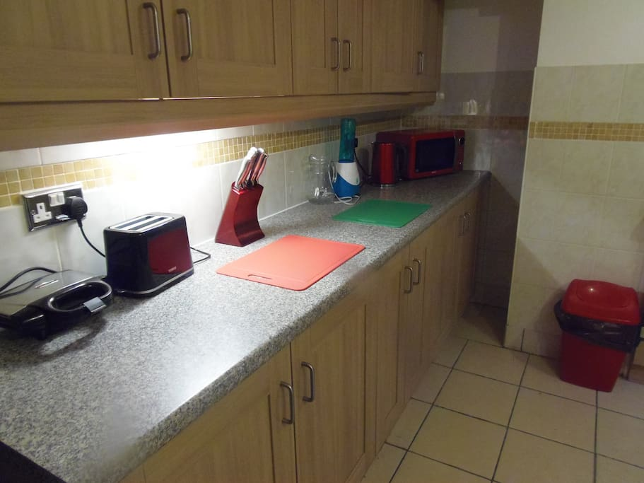 other side of the kitchen lot of storage space and cooking area