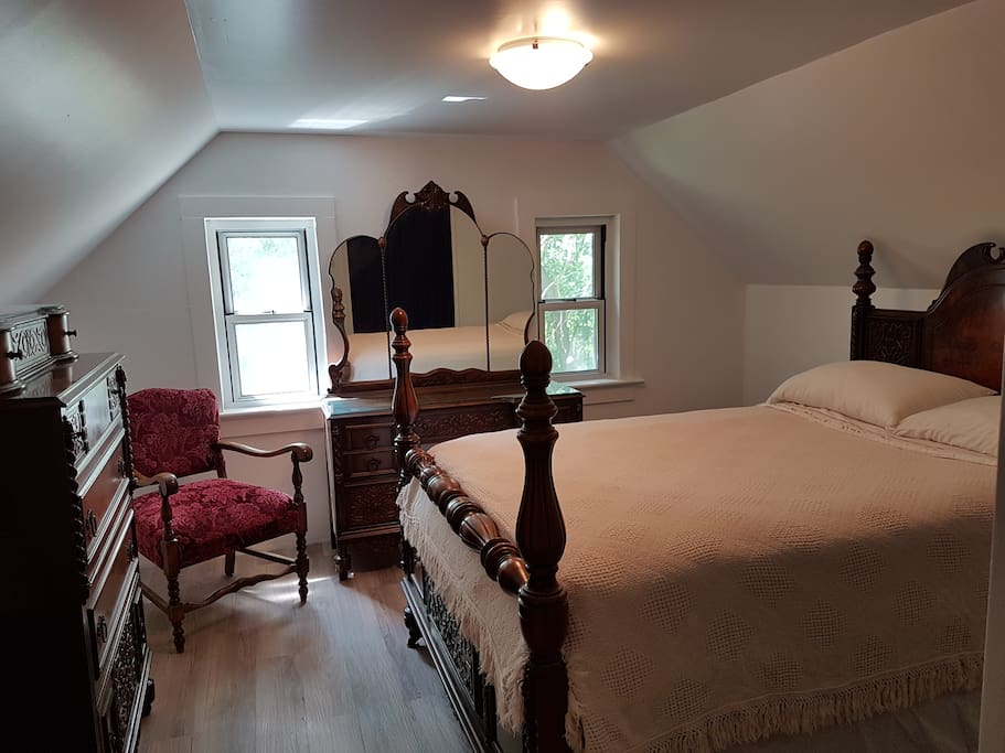 Upstairs guest bedroom with a double bed.  Wake to the music of Silkie roosters!