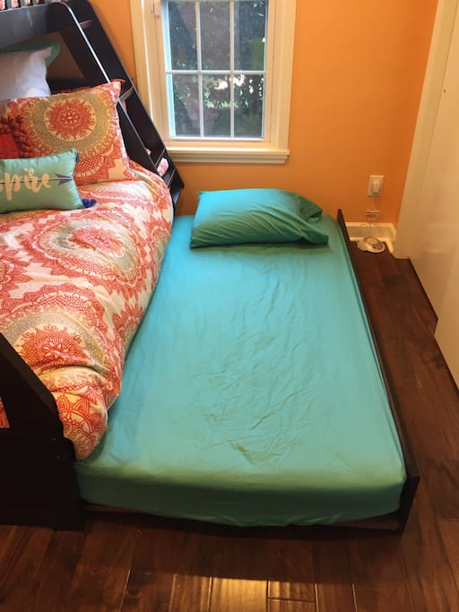Bunk bed can accommodate either 3-4 guests depending on the configuration.  To sleep the maximum of 4, just roll the trundle bed out from under the bottom bunk. To sleep 3 just easily roll the trundle bed back under the bottom bunk for easy storage. The bedroom is directly beside a guest bathroom that has all toiletries needed including hair dryer, curling iron, shampoo, conditioner, feminine products, and other items. *** Please Note - this guest bathroom is shared with another guest suite when that particular suite is being utilized. ***