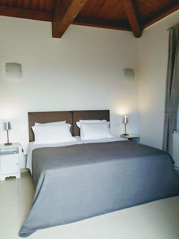 One of the 3 bedrooms which have 'super king' zip and link beds.