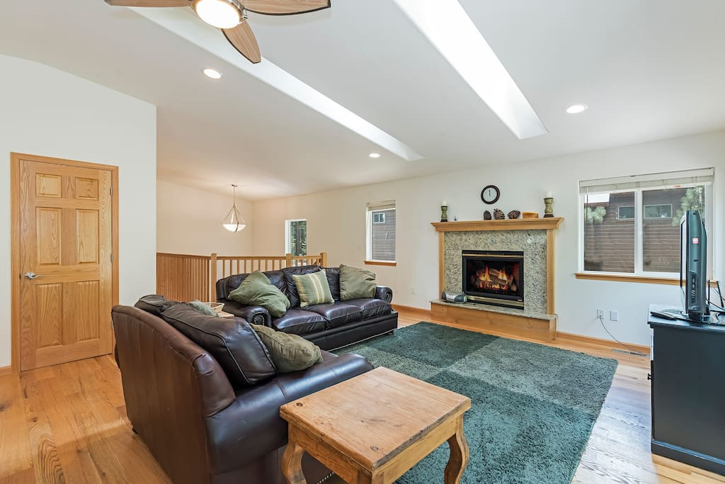 Living room with a gas fireplace and comfortable couch seating
