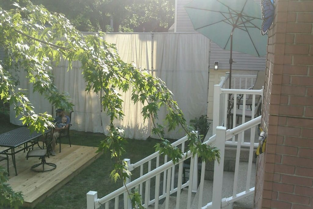 Back yard, stairs to living area, back deck and my Roman privacy wall/curtain.