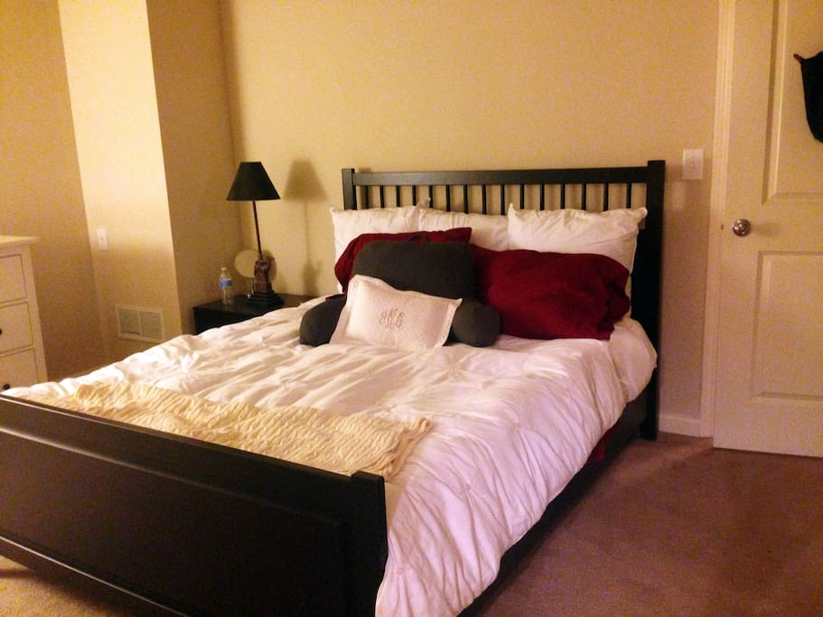 Queen Bed with ceiling fan overhead