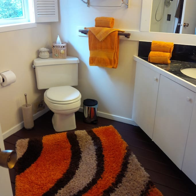 Neat and clean bathroom with shower...