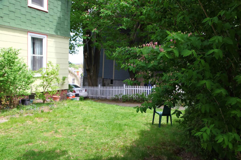 This is the front yard; no smoking allowed in house, so there is a smoking area with seating out front instead.
