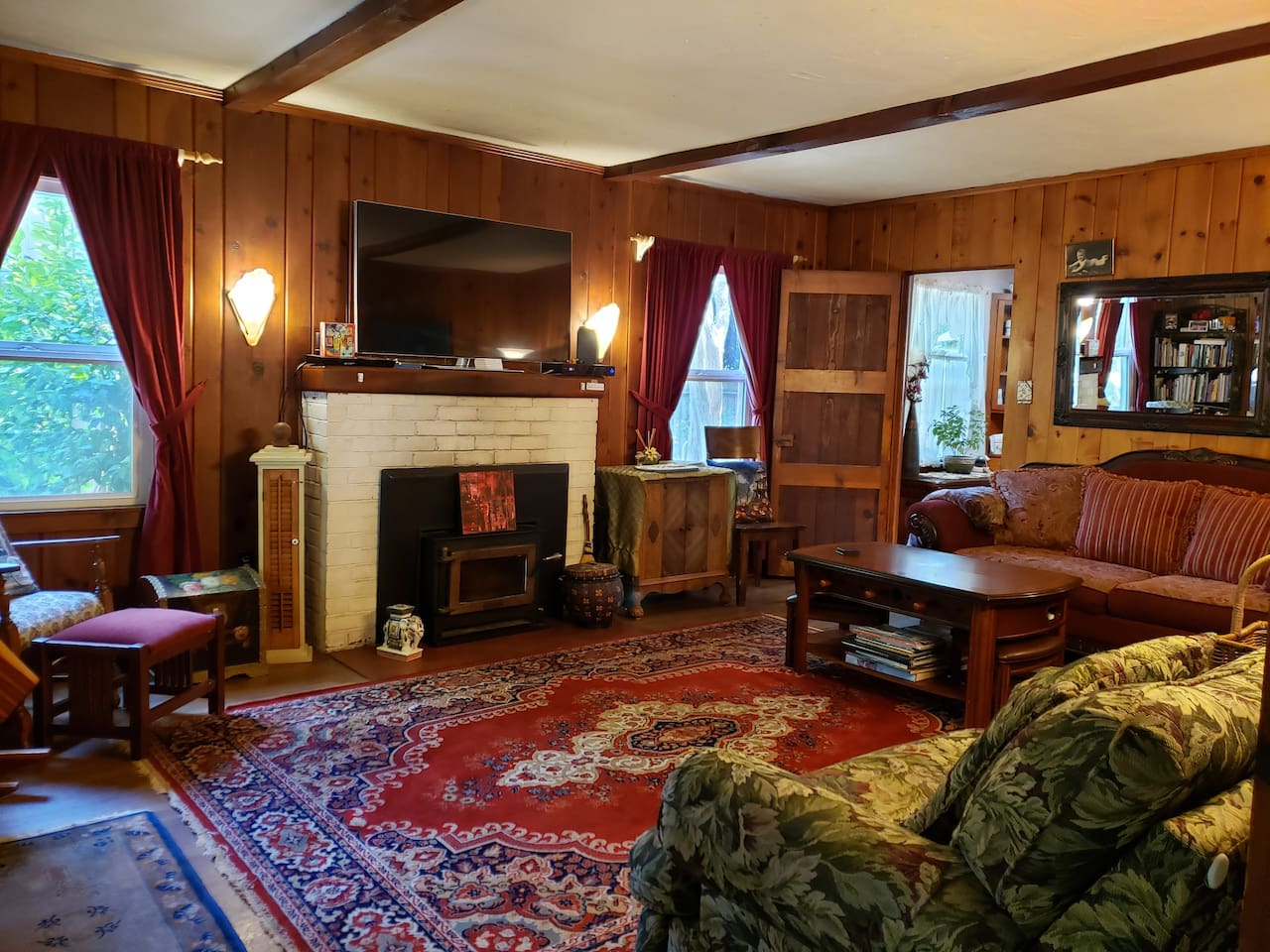 Living room has a wood stove, huge flat screen t.v. (with Xfinity and Wifi) Two comfy, wide chairs with foot rests that pop out when needed. Vintage knotty pine walls give the feeling of a lodge. Central heat/air throughout...and a foosball table!!1