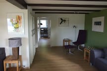 Other end of the L-shaped sitting room. You can look straight through the kitchen into the dining room.