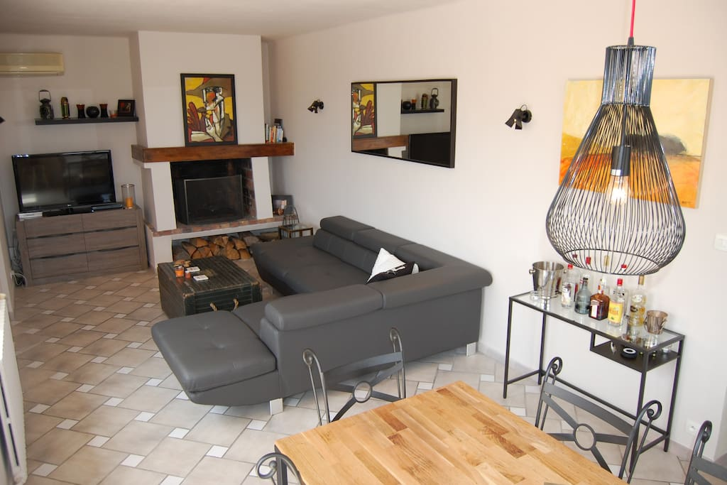 Living area with large sectional, TV, fireplace