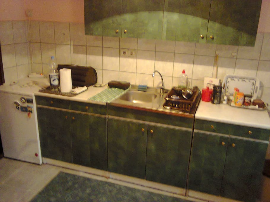 Small kitchen with a stove and fridge.