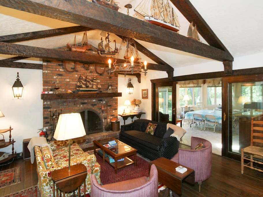 Comfortable seating and a functional fireplace in the second living room