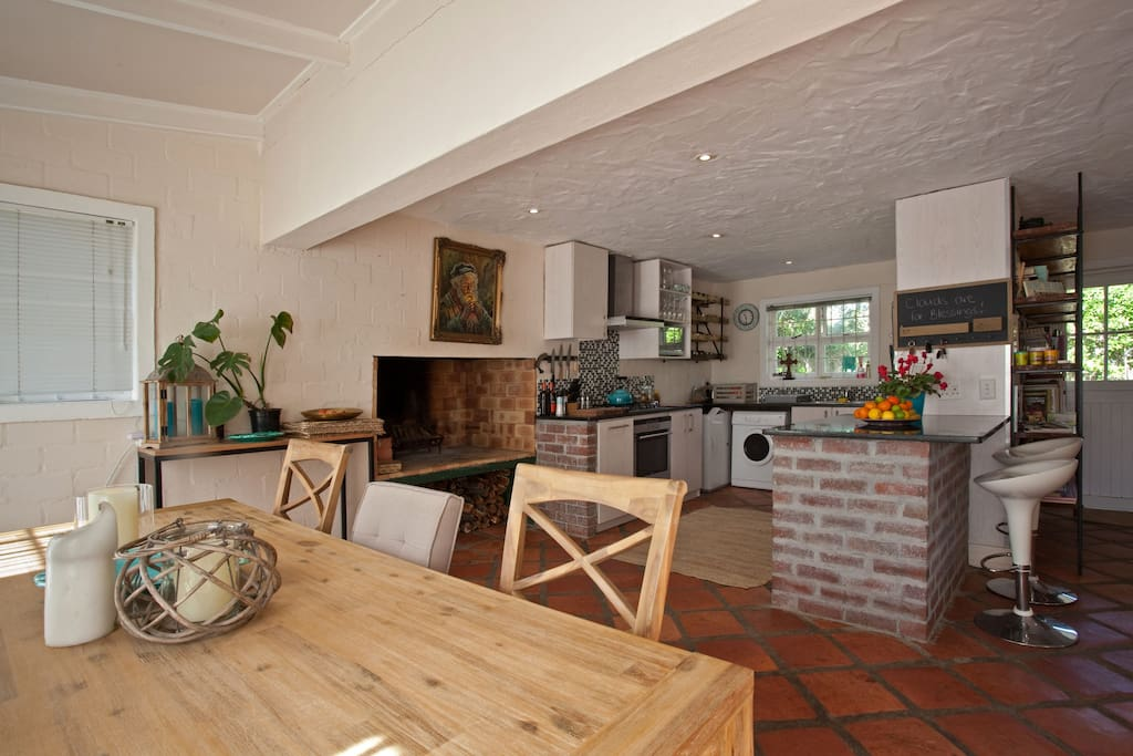 Open Plan Kitchen and Dining room with indoor fireplace and BBQ area
