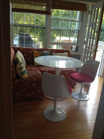 Breakfast nook, off kitchen, right near door to deck.