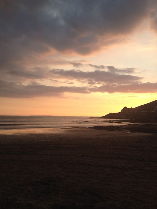 Watch the sunset over Baggy Point from Croyde beach.