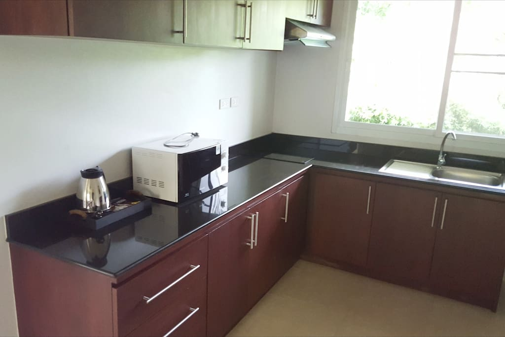 Kitchen counter with electric range Villa B