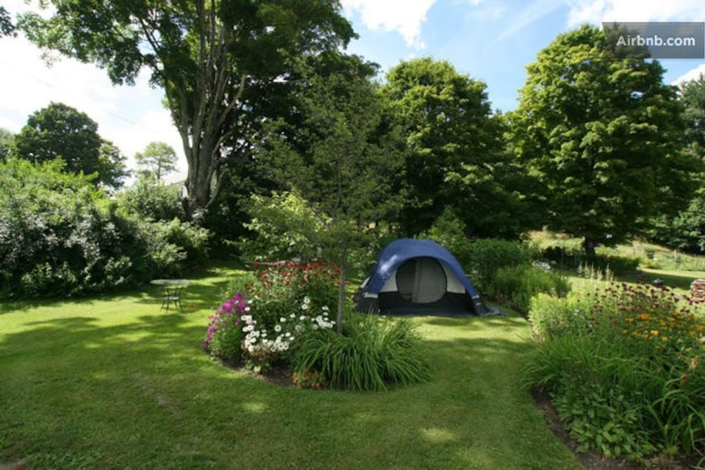 Some people like to set their tent here, amid the gardens, but it is close to the house.