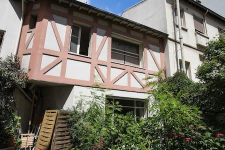 Maison au coeur de Paris
