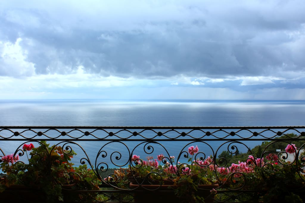 The balcony with the stunning sea view and garden