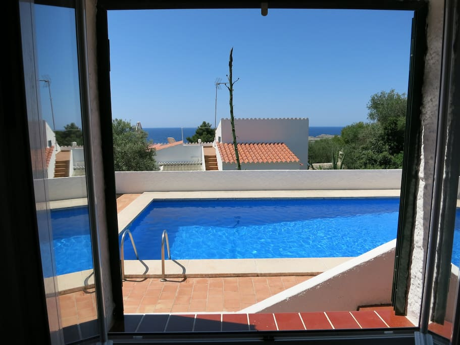 View of pool and sea from bedroom 1