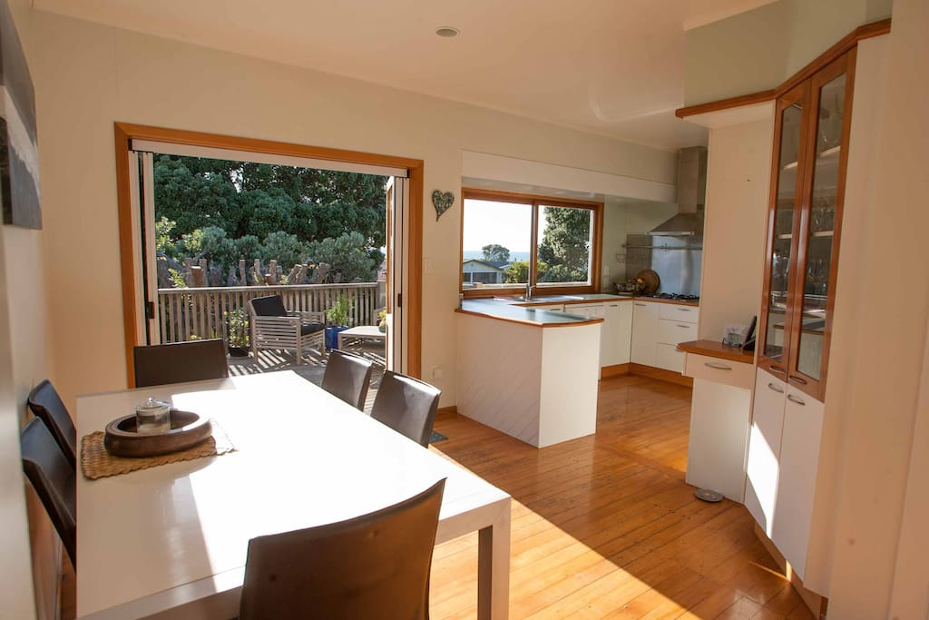 Open plan kitchen which opens to the front deck