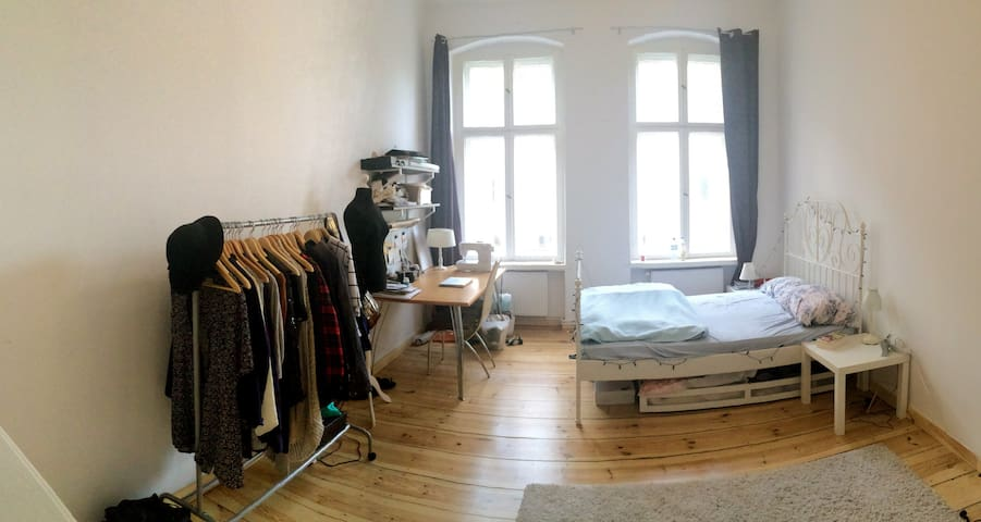 big, bright room with a double bed