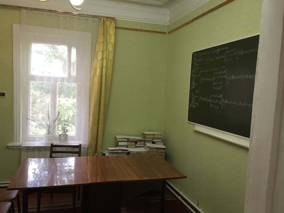 A sitting room with a blackboard