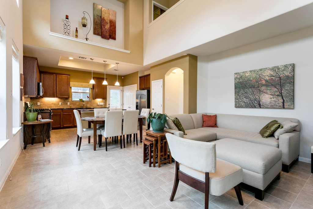 Spacious, lofted kitchen, dining area and living room with vaulted ceilings