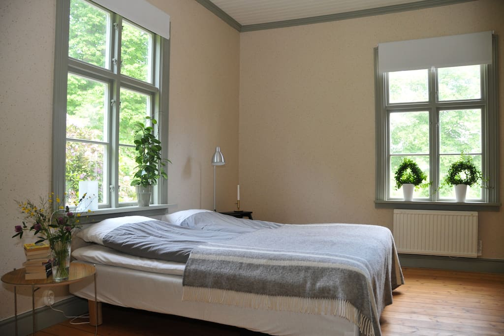 Master bedroom with a comfortable bed.